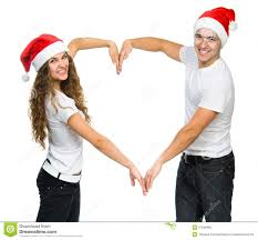 beautiful christmas couple in santa hats stock photo image 27548990