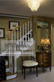 black entry hall table entry hall traditional gold wallpaper black carpet runner on