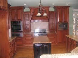 stained cherry wood kitchen w maple painted black distressed