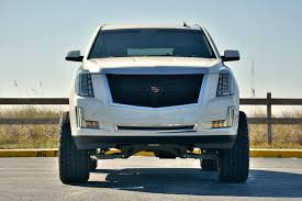 lift kits for cadillac escalade lifted cadillac escalade wears 22 inch nightmare