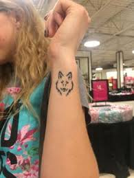 wolf tattoo behind ear small wolf on wrist or behind ear ink pinterest wolf tribal
