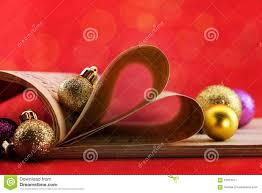 music notation book with pages shaping heart and christmas
