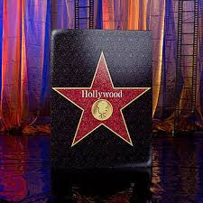 this camera walk of fame star standee features a red and gold star