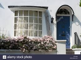 bow window and arched window light door entrance to a private