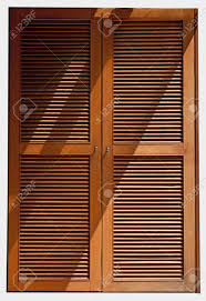 wood jalousie door texture with lighting stock photo picture and