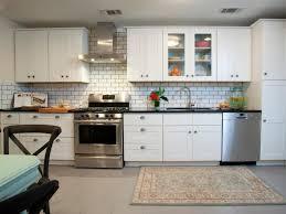 white subway tile backsplash with dark grout grey kitchen floor