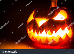 halloween black background pumpkin halloween scary face pumpkin on black stock photo 218623786