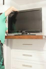 remodelaholic how to install a sliding tv platform