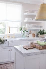 white kitchen idea 12 photo of white kitchen cabinets with white marble countertops