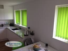lime green vertical blinds in a kitchen harmony blinds of bolton