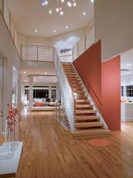 a large floating staircase helps to break up this open plan