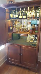 kitchener wine cabinets diy converted a tv hutch into a lit up liquor cabinet