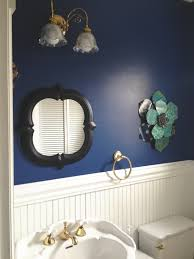 dark blue walls with white wainscoting in bathroom very nice