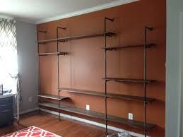 Steel Pipe Shelving by Custom Designed Industrial Style Pipe Shelving For Entertainment