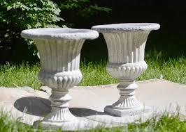 curiositaellya black urn planters turned white diy