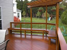 deck with bench seats and trellis sitting on the front deck