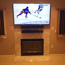 Tv Mount Over Fireplace by Tv Mounting Over A Fireplace With Wires Concealed In The Wall