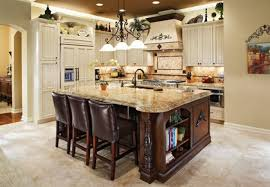 kitchen kitchen ideas cream cabinets table linens wall ovens