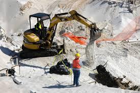 file us navy 060324 5328n n 324 using a mini excavator a heavy