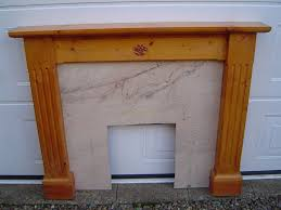 solid pine fireplace surround with marble look insert in moulton