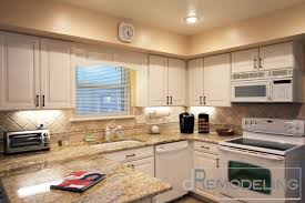 white kitchen color in counter give warmth and tile