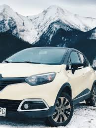renault white white renault clio 4 on snow covered road free stock photo