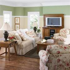 living room recomended decorating ideas for small homes modern modern small home design flower patterned accent sofa two toned walls dark finished furniture wooden flooring simple desk lamp