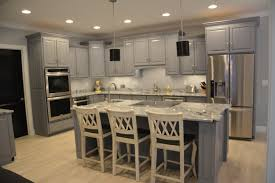 our kitchen with grey cabinets viscon white granite and pops of