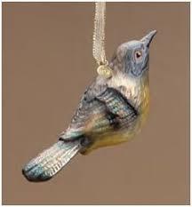 marjolein bastin robin on birdfeeder ornament nature s journey