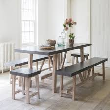 style guile a dining table with a difference the arden table and bench set from graham green 1800 has a cement fibre top and is 240cm long which is a pretty good size my problem is that i m not