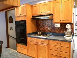 kitchen basement kitchen with natural wood kitchen cabinet