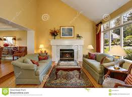 brilliant living room with green sofas and yellow walls stock