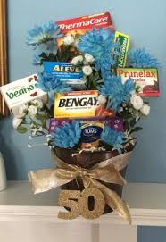 birthday gift for turning 60 age remedies tucked into a flower arrangement is a comforting