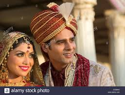 indian bride and groom in traditional wedding dress stock photo