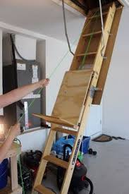 versa lift attic lifts home garage storage lifts by versalift