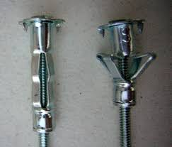 Install Curtain Rod Drywall Hanging Curtains On A Plaster Wall With Plastic Anchors Drill