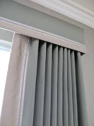 cornice and curtains with contrast trim can always just do a