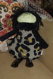 woof and poof woof poof fall small witch in leopard by woof poof