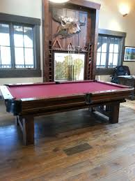 pool tables dining with wooden table and red cushion design feat