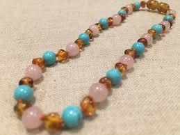 pink turquoise necklace images Baltic amber hazelwood teething necklace naturally manage pain jpg