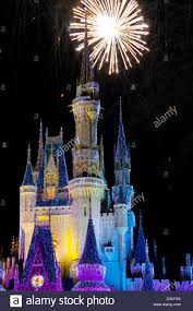 disney world castle at with lights and fireworks stock photo