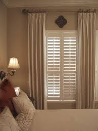 Curtains For Master Bedroom Combining Plantation Shutters With Curtains Privacy Cosiness