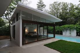 pool house plans with bedroom poolhouse bedroom floor to ceiling windows interior design ideas