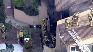2 dead after plane crashes into townhouse complex near hawthorne