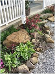 rustic flower beds with rocks in front of house ideas 3 rustic