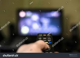 Couch Potato Tv Remote Control Hand Front Tv Couch Stock Photo 563532037
