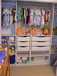 interior simple baby closet organizer with white two doors and