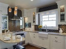mosaic glass backsplashes under wooden cabinets in the kitchen