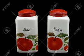 vintage ceramic salt and pepper shakers with red caps and fruit