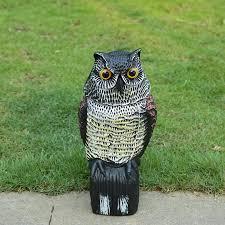 decoy simulation animal shook his plastic owl decoy